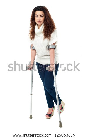 n limping with crutches, recovering from accident. - stock photo