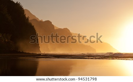 Na Pali coast by Ke'e beach in Kauai at sunset - stock photo