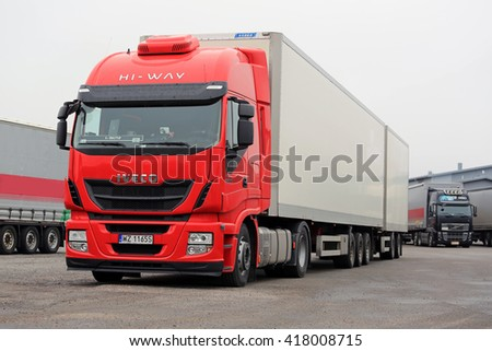 NAANTALI, FINLAND - APRIL 9, 2016: Red Iveco Stralis 460 Euro 6 and other cargo trucks on warehouse yard in South of Finland. - stock photo