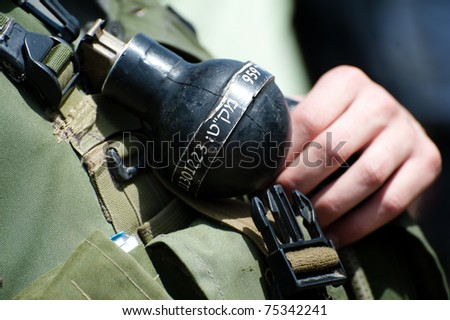 "NABI SAMUEL, OCCUPIED PALESTINIAN TERRITORIES - APRIL 1: A ""rubber ball"" gas or sound grenade used for crowd control is clipped to the uniform of an Israeli soldier on April 1, 2011 in Nabi Samuel."