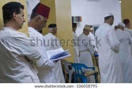 NABLUS, WEST BANK - JUNE 24 : Members of the ancient Samaritan community prays during the holy day of Shavuot in Mount Gerizim on June 24 2012,