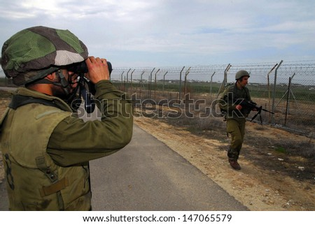 NACHAL OZ, ISR - FEB 25: Israeli Infantry Corps guards along Gaza Strip on Feb 25 2008.The barrier protect Israeli civilians from Palestinian terrorism and suicide bombing attacks. - stock photo