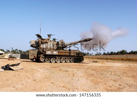NACHAL OZ , ISR - JULY 06:Israeli artillery M109 howitzer on July 6 2006.It's the most common Western indirect-fire support weapon of maneuver brigades of armored and mechanized infantry divisions. - stock photo