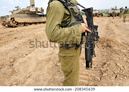 NACHAL OZ, ISR - NOV 12 2008:Israeli soldiers and Merkava tank. It's IDF battle tank designed for rapid repair of battle damage, survivability, cost-effectiveness and off-road performance - stock photo