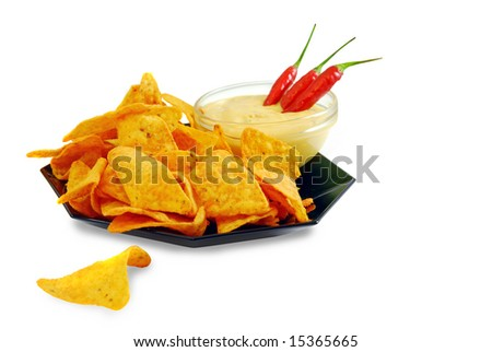Nacho cheese tortilla chips with guacamole dip and chili peppers, isolated on white background - stock photo