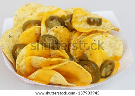 Nacho chips, cheese and peppers - stock photo