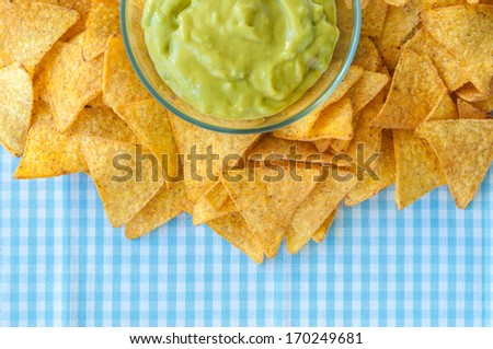 Nacho chips with fresh guacamole dip - stock photo