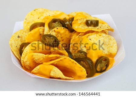 Nacho chips with peppers - stock photo