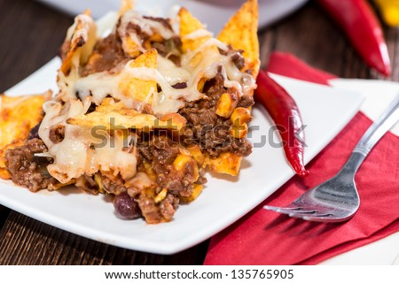 Nacho gratin with Cheese and Chili con Carne - stock photo