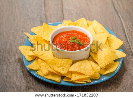 Nachos and tomato dip  - stock photo