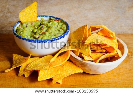 Nachos chips and guacamole dip - stock photo