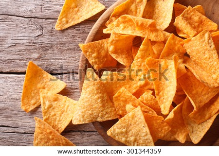 Nachos corn chips in the bowl on the table close-up. Horizontal top view