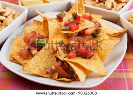 Nachos corn chips with fresh homemade salsa - stock photo