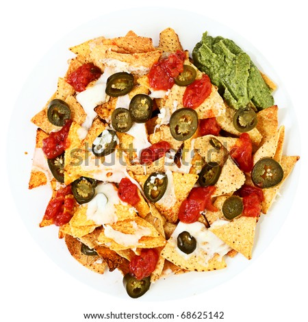 Nachos plate with jalapenos, chilli, mozzarella cheese, guacamole and spicy tomato salsa. Isolated on white background. - stock photo
