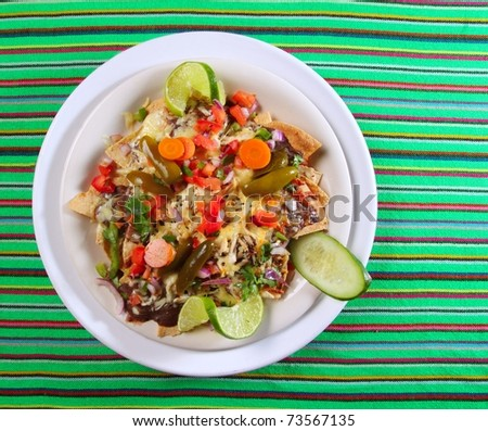 Nachos totopos prepared with cheese vegetables chili Mexican food style - stock photo