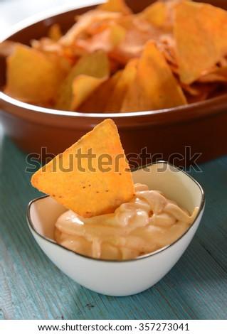 Nachos with cheese dip - stock photo