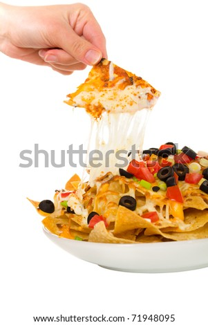 Nachos with vegetable on the top. Isolated on a white background.  Focus in on the meal. - stock photo
