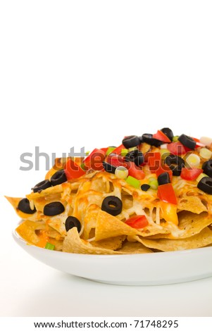 Nachos with vegetable on the top. White background.  Very shallow depth of field. - stock photo
