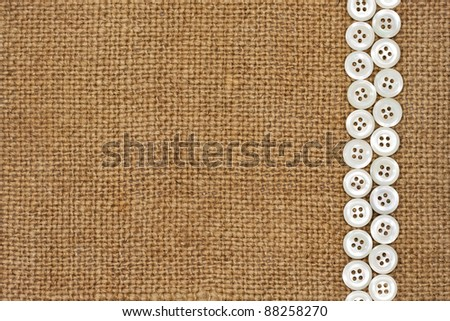 Nacre buttons on fabric texture background - stock photo