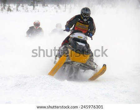Nadim, Russia - April 19, 2009: Snoukross. Vadim Vasuhin jump in with springboard on snowmobile during snow cross-country in Nadim, Russia - April 19, 2009.