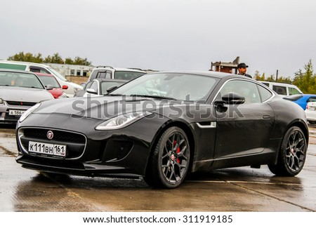 NADYM, RUSSIA - AUGUST 29, 2015: Motor car Jaguar F-Type at the city street. - stock photo
