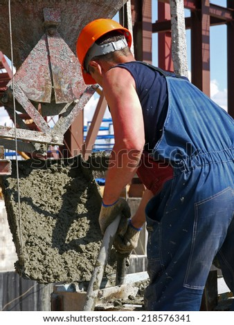 NADYM, RUSSIA  - JUNE 6, 2011: Equipment of corporation GAZPROM in Novy Urengoy, YANAO, JUNE 6, 2011 in Nadym, Russia. Unknown man, a construction worker in the work.