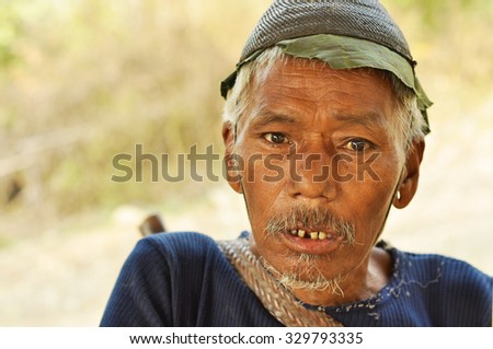 Nagaland, India - March 2012: Portrait of old mans face in Nagaland, remote region of India. Documentary editorial.