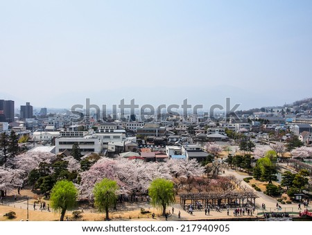 NAGANO-APR 17: Matsumoto city from the top of Matsumoto castle in Nagano, Japan on April 17, 2014. The city is surrounded by mountains and is acclaimed for its beautiful views and calm climate. - stock photo