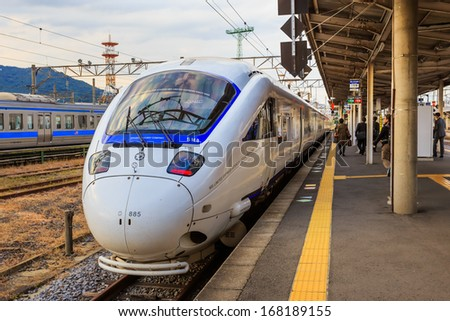 NAGASAKI, JAPAN - NOVEMBER 14: Limited express in Nagasaki, Japan on November 14, 2013. Sonic 885 is an AC electric multiple unit tilting train type operated on limited express services by JR Kyushu - stock photo
