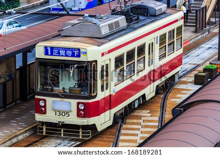 NAGASAKI, JAPAN - NOVEMBER 14: Tram in Nagasaki, Japan on November 14, 2013. Served by 4 tram lines, provide easy access to most city's main attractions and run every 5-8 minutes