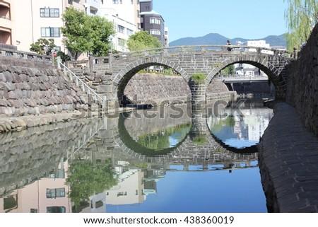 Nagasaki,Nagasaki Prefecture ,Japan-October 20,2015:Megane Bridge, over the Nakashima River was built in Nagasaki in 1634 by the Japanese monk Mokusu of Kofukuji Temple. - stock photo