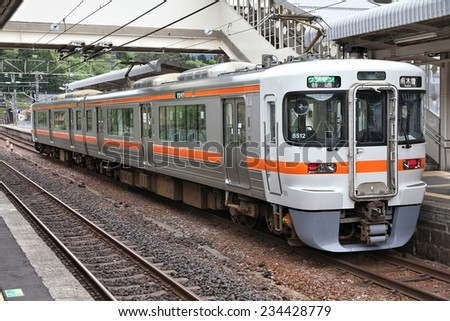 NAGISO, JAPAN - MAY 2, 2012: Central Japan Railway Company electric train of 313 series stands at Nagiso station. JR Central had 134 billion JPY in net income for 2011.