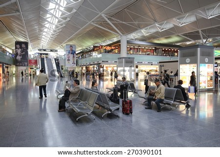 NAGOYA, JAPAN- APRIL 15, 2015: Unidentified people travel at  Chubu Centrair International Airport on April 15,2015.Chubu airport is an airport on an artificial island in Ise Bay Aichi. - stock photo