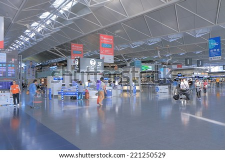 NAGOYA JAPAN - SEPTEMBER 27, 2014:Unidentified people travel at Central Japan Centrair Airport - Central Japan airport is an airport on an artificial island in Ise Bay Aichi. - stock photo