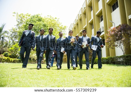 NAGPUR, MAHARASHTRA, INDIA, 13 APRIL 2016 : unidentified group of happy young MBA students walking together and doing fun at university campus.
