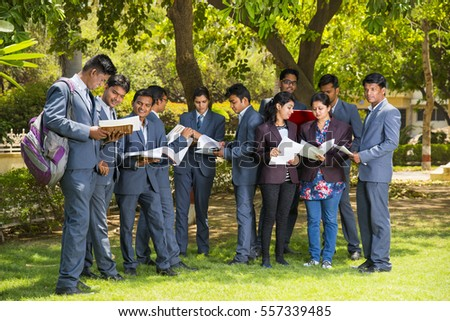 NAGPUR, MAHARASHTRA, INDIA, 13 APRIL 2016 : unidentified group of young MBA students talking together about their studies project at university campus.