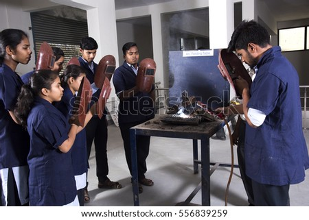 NAGPUR, MAHARASHTRA, INDIA, 13 APRIL 2016 : Unidentified Students of engineering studying and working together in workshop.