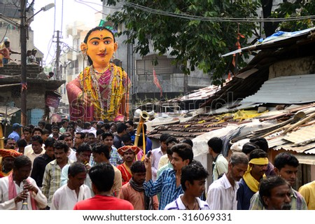 NAGPUR, MS, INDIA - SEPT 13: procession of Marbat festival is celebrated to protect the city from evil spirits and they make statues of evil forces.  on Sept 13, 2015 in Nagpur, Maharashtra, India.