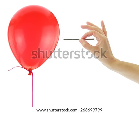 Nail about to pop a balloon isolated on white - stock photo