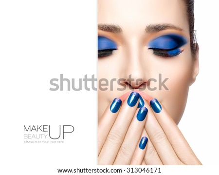 Nail art and makeup concept. Beautiful young woman with hands on her face covering her mouth. Perfect skin. Trendy make-up. High fashion Portrait isolated on white. Template design with sample text - stock photo