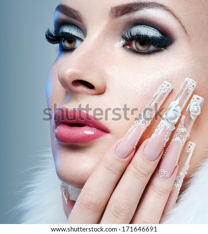 Nail art. Beautiful Woman With perfect  Nails and Luxury Makeup. - stock photo