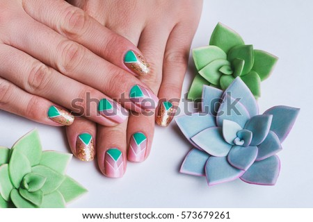 Nail art bright gold pink green stock photo 573679261 shutterstock nail art with bright gold pink and green chevron pattern on light background prinsesfo Image collections
