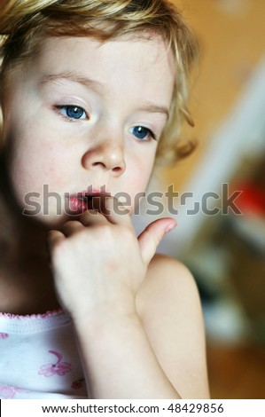nail-biting - bad habit for children in soft focus - stock photo
