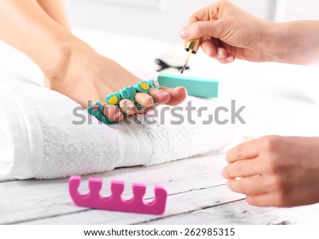 Nail Care, Foot Care. Foot care treatment and nail, the woman at the beautician for pedicure. - stock photo
