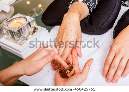 nail care. Girl makes a manicure in a beauty salon - stock photo
