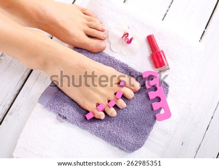 Nail clipping, cutting skins pedicure treatment. Foot care treatment and nail, the woman at the beautician for pedicure. - stock photo