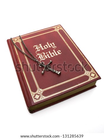 Nail Cross on a red leather bible - isolated on white. - stock photo