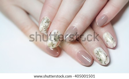 Nail design . Manicure nail paint . beautiful female hand with colorful nail art design manicure - stock photo