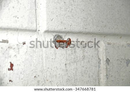nail in the wall