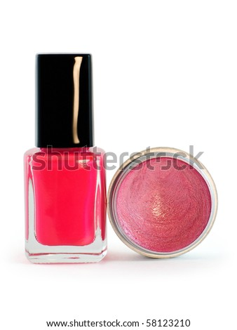 Nail polish and lip gloss in pink range on white background - stock photo